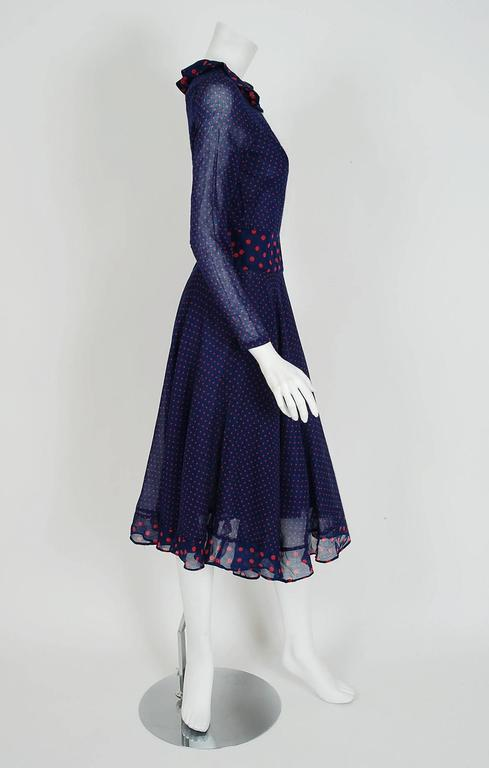 Gorgeous Thea Porter dress fashioned in navy and pink polka-dot print cotton voile. I love the beautiful color combination and clear nod to 1930's fashion. The silhouette is a flattering nipped waist tea-length with a flowing swing-skirt. I adore
