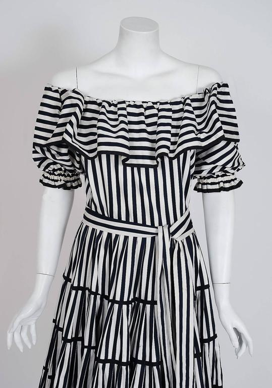 Breathtaking Yves Saint Laurent black and white striped cotton sundress from the infamous Rive Gauche collection during the mid-1970's. Pieces from this decade are very rare and are true examples of fashion history. I adore the low-cut plunge