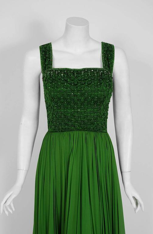 Rosalie Macrini had her start designing for the famous Barbara Costume Company in New York, going on to buy the business in 1954. Macrini was best known for opulent evening looks and for her unique use of extravagant fabrics. This breathtaking olive