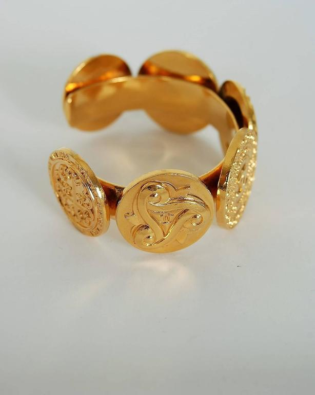 1992 Chanel Rare Novelty-Logo Button Charms Medallion Gold Cuff Bracelet In Good Condition For Sale In Beverly Hills, CA