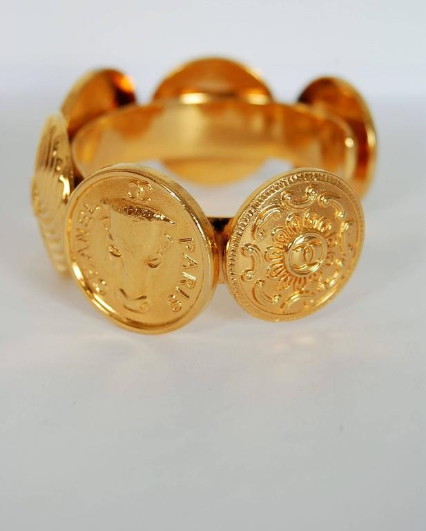 1992 Chanel Rare Novelty-Logo Button Charms Medallion Gold Cuff Bracelet For Sale 1