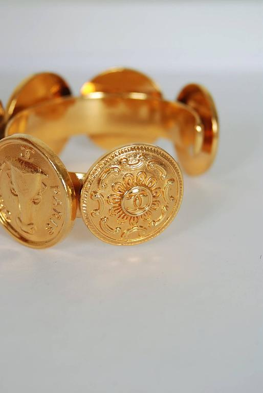 Women's 1992 Chanel Rare Novelty-Logo Button Charms Medallion Gold Cuff Bracelet For Sale