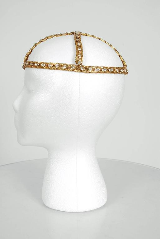 Opulent 1920's French metallic-gold brass and rhinestone flapper evening headpiece. This is, without a doubt, one of the most extraordinary antique Juliet caps I have ever laid eyes on. Prong-set rhinestones with tons of sparkle on gorgeous