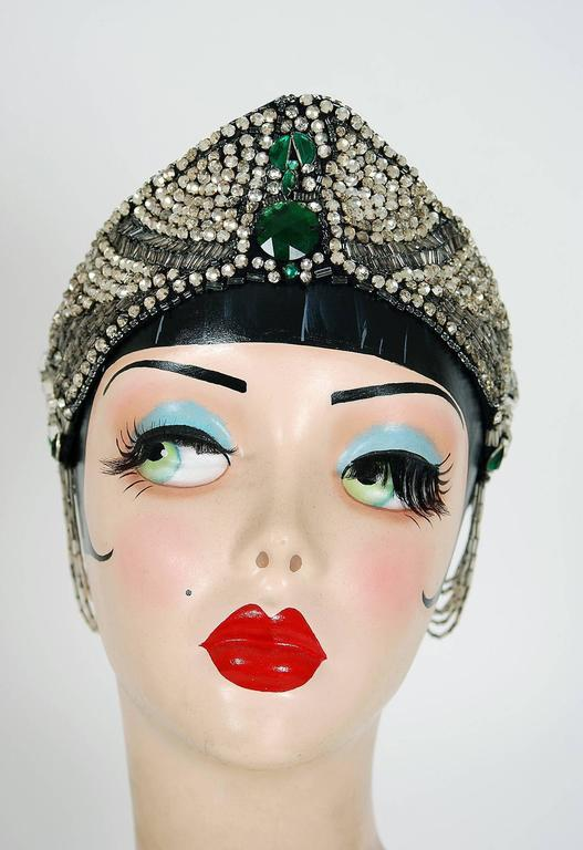 Breathtaking 1920's French couture emerald-green and clear jeweled flapper evening headpiece. This is, without a doubt, one of the most extraordinary antique crowns I have ever laid eyes on. Prong-set rhinestones and tube glass-beads with tons of