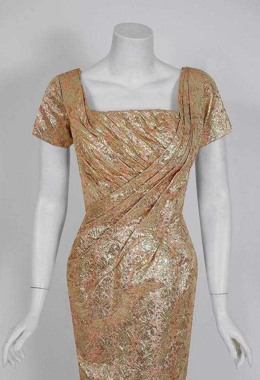 This is such a seductive and dramatic cocktail dress from the iconic Ceil Chapman designer label. Perfect for any upcoming party; you can't help but feel feminine in this beauty! The garment is fashioned from a stunning metallic gold floral