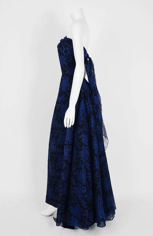 Breathtaking sapphire-blue roses floral chantilly-lace gown created by Italian designer Fernando Sarmi when he was head designer for Elizabeth Arden in the 1950's. Ferdinando Sarmi expressed interest in fashion during his youth but was discouraged