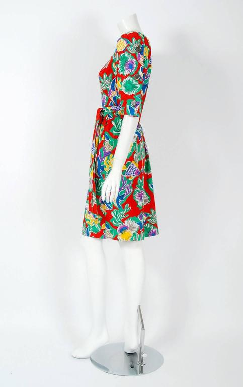 Breathtaking Yves Saint Laurent colorful novelty tropical fish-print cotton dress from the infamous spring/summer 1981 Rive Gauche collection. Pieces from this decade are very rare and are true examples of fashion history. The bodice has a gorgeous