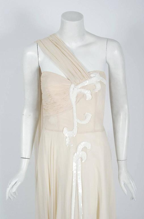Ethereal 1940's Saks Fifth Avenue ivory-creme goddess gown from the Old Hollywood era of glamour. This stunning silk-chiffon garment has so much couture detail, you can tell it was made with expert devotion. The boned sweetheart plunge bodice is