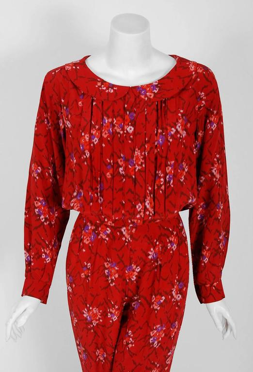 This extremely chic Lanvin treasure, in the most stunning ruby-red graphic floral print, is a statement piece. It manifests liveliness and makes you feel confident. The bodice has a chic peter-pan collar with three-dimensional couture pleating. I