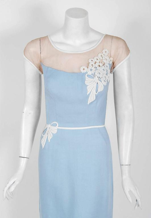 An amazing and highly stylized 1950's cocktail dress by the famous American designer Peggy Hunt. Starting in the 1930's through the early 1960's, she was immensely successful with her specialized cocktail and evening dresses. Her garments were often