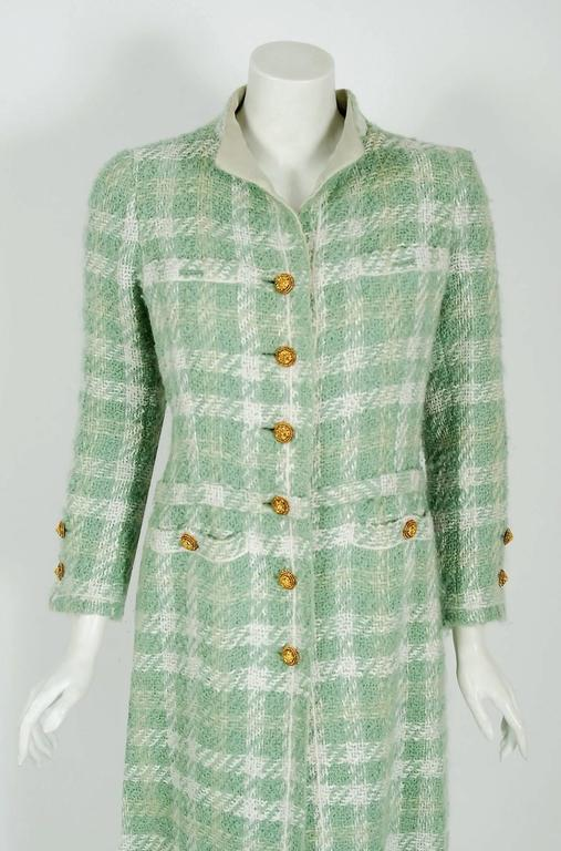 Chanel is known to be one of the most luxurious and decadent fashion houses in the world. This breathtaking seafoam green boucle plaid wool coat from her 1970 Spring.Summer collection is a perfect example of why this couture brand has stood the test