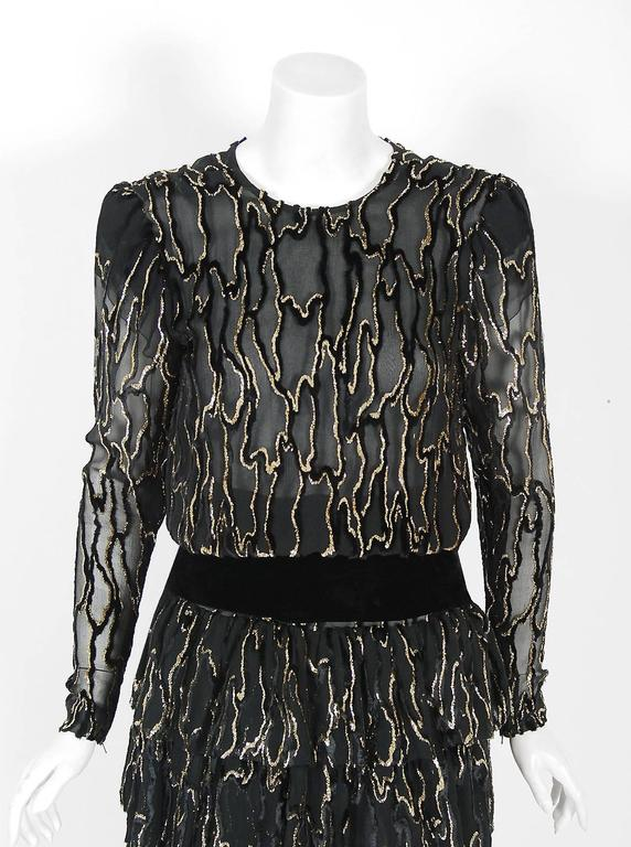 Givenchy, the name itself evokes glamour, refined elegance, simplicity and style. Givenchy's trademark of sculpted lines and luxurious fabrics make his work easily recognizable. This gorgeous cocktail dress, dating back to his 1979 collection, is a