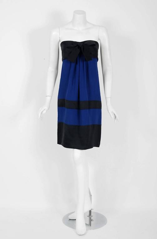 Chanel is known to be one of the most luxurious and decadent fashion houses in the world. This gorgeous sapphire-blue and black cocktail, dating back to 1992, is a perfect example of why this couture brand has stood the test of time. Not only is