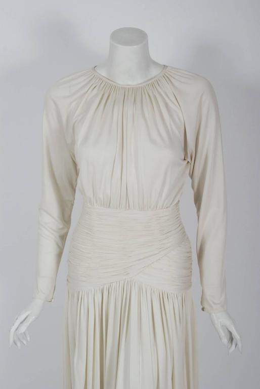 1992 Oscar de la Renta ivory-white goddess gown with original $3300 Saks Fifth Avenue price tags. Oscar de la Renta was one of the world's leading fashion designers. Trained by Cristóbal Balenciaga and Antonio Castillo, he became internationally