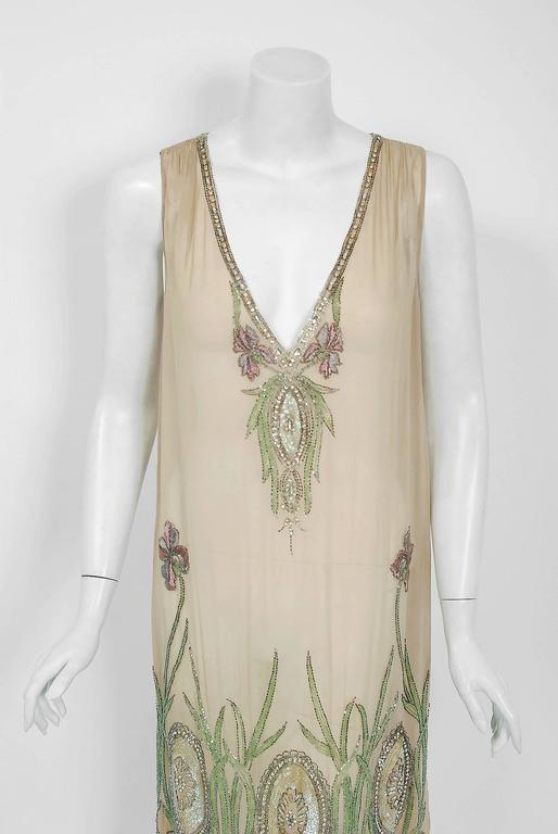 There are lots of lovely 1920's garments still around, but every once in a while I come across one that sets my heart a flutter! This is an extraordinarily beautiful and exceptional French couture museum quality nude silk-chiffon dance dress. The