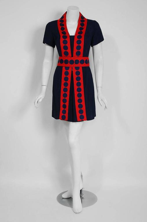 Truly a wonderful and unique space-age designer dress by Richard Frontman. I think this is one of the best examples of 1960's graphic mod fashion I have seen in a long time. The design was obviously inspired by Courreges and Cardin who were the