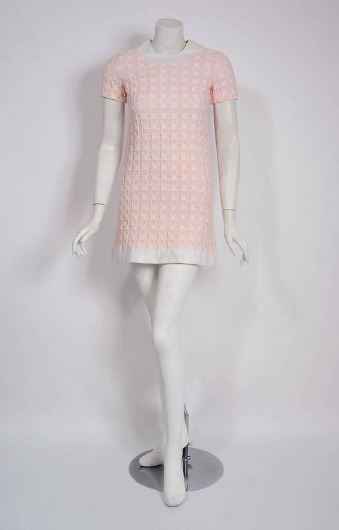 Magnificent Pierre Cardin mod dress in an elegant pink and white color combination from his iconic 1966 documented collection. In 1951 Cardin opened his own couture house and by 1957, he started a ready-to-wear line; a bold move for a French