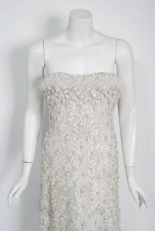 Breathtaking Pierre Balmain Haute-Couture ivory metallic embroidered lace gown dating back to his 1963 collection. This iconic designer created a very sculptural quality which was always allied with a ladylike essence. His garments have a body and a