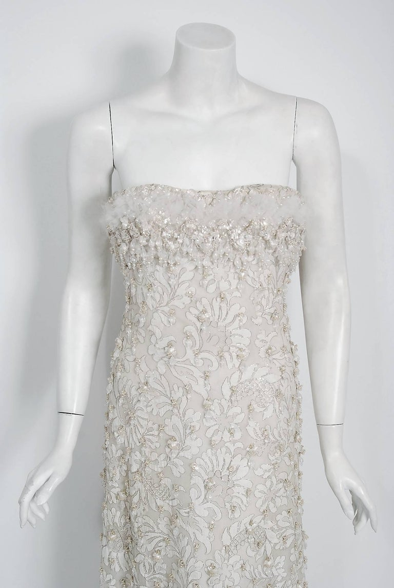 Breathtaking Pierre Balmain Haute Couture ivory metallic embroidered lace gown dating back to his 1965 runway collection. This iconic designer created a very sculptural quality which was always allied with a ladylike essence. His garments have a