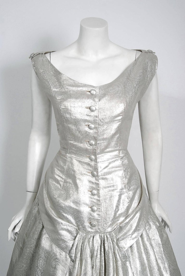 Sparkling Suzy Perette designer metallic silver lamé cocktail party dress dating back to the mid 1950's. Suzy Perette was not an actual person, but the name of a dress manufacturing company that made affordable versions of haute-couture Parisian