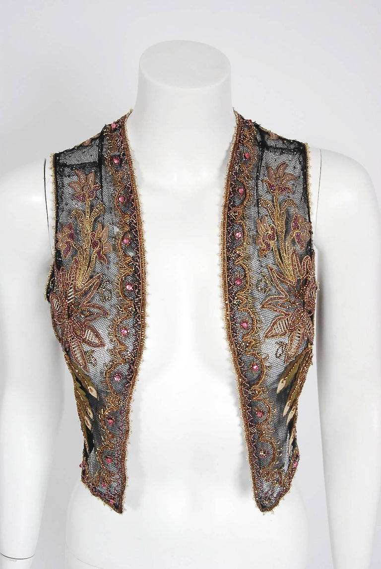 """This sensational 1910's French Edwardian bolero vest is lavishly embellished with glossy glass beads and sparkling jewels throughout. The highly stylized floral embroidery perfectly captures the Art Nouveau aesthetic. Double layered """"light as a"""