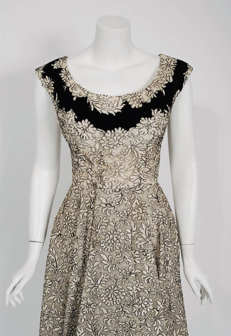 Breathtaking ivory and black corded illusion floral lace party dress created by Italian designer Fernando Sarmi when he was head designer for Elizabeth Arden in the 1950's. Sarmi developed a wonderful reputation as a top designer, wooing an