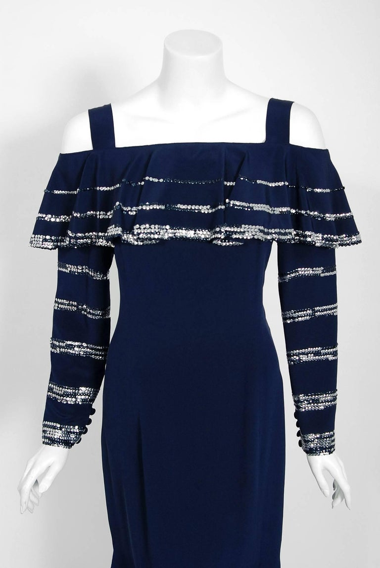 A breathtaking Karl Lagerfeld for Chloe navy-blue silk bohemian glam dress dating back to the mid 1970's. He uses an ingenious ruffle technique which really gives the garment so much depth and texture. The