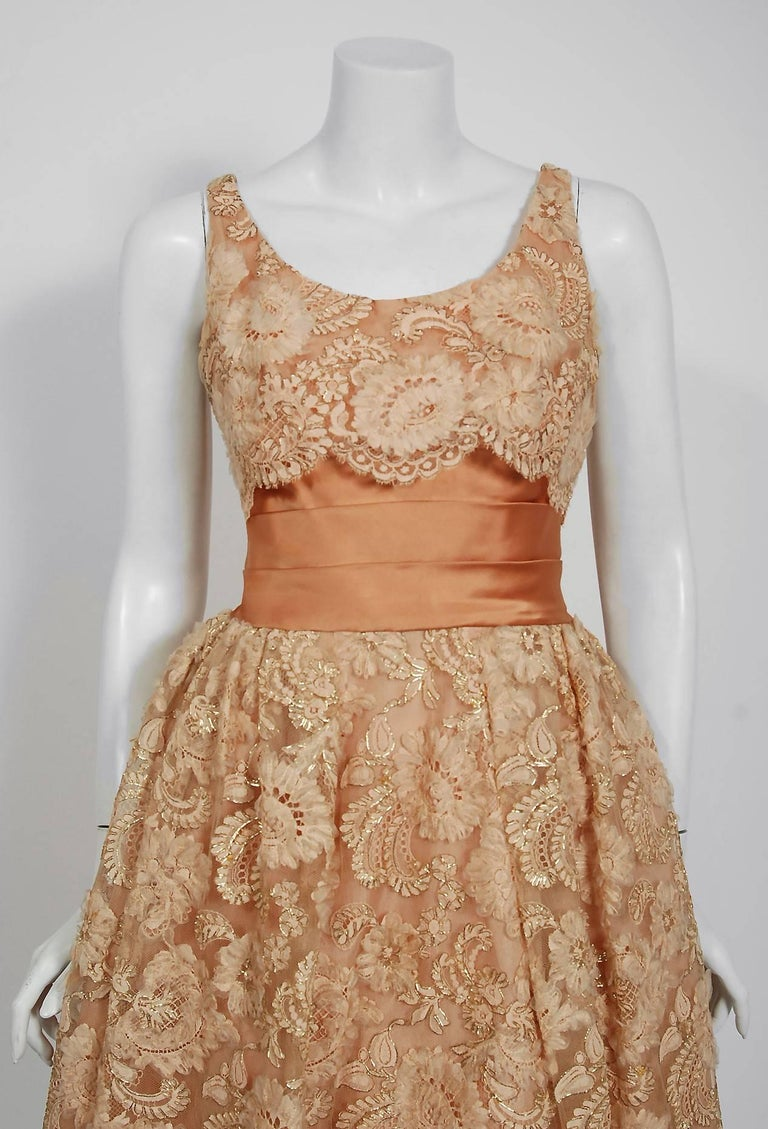 Breathtaking and incredibly chic Rudolf couture designer golden peach party dress dating back to the mid 1950's. The company, started by Max Cory Rudolf, was an upscale boutique in New York City that catered to very prestigious and wealthy
