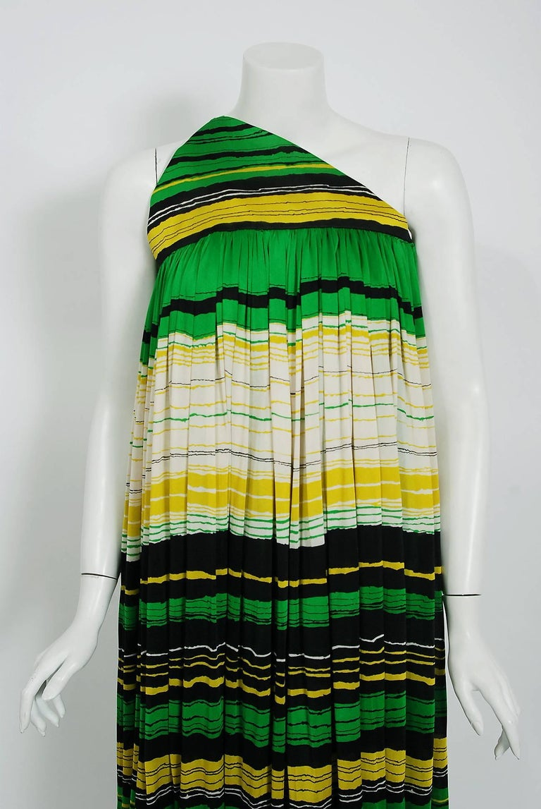 Gorgeous Geoffrey Beene green, yellow and black striped silk-jersey dress dating back to his 1966 collection. The same garment, in a pink shade, was famously worn by Sharon Tate. Geoffrey Beene made strong impressions with his courteous manner as