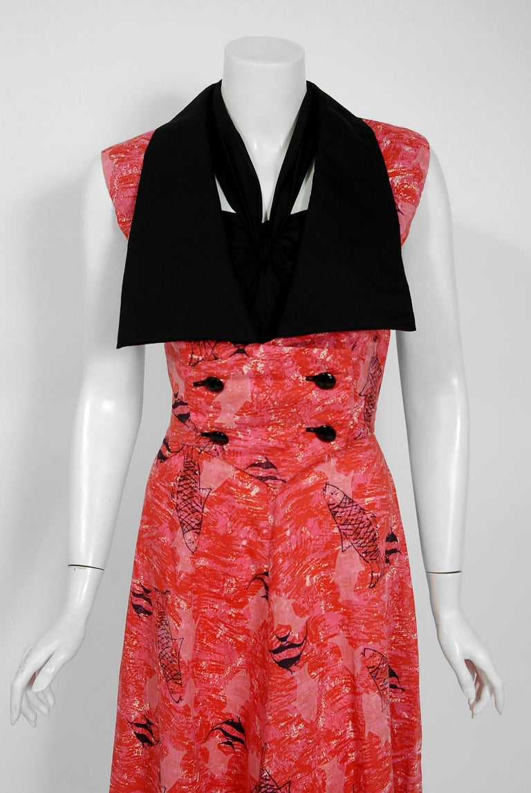 With its vibrant swimming fish novelty print and flawless styling, this Margaret Newman designer dress ensemble has the casual elegance the 1940's were known for. The fully-boned sweetheart plunge bodice with halter strap is very flattering and