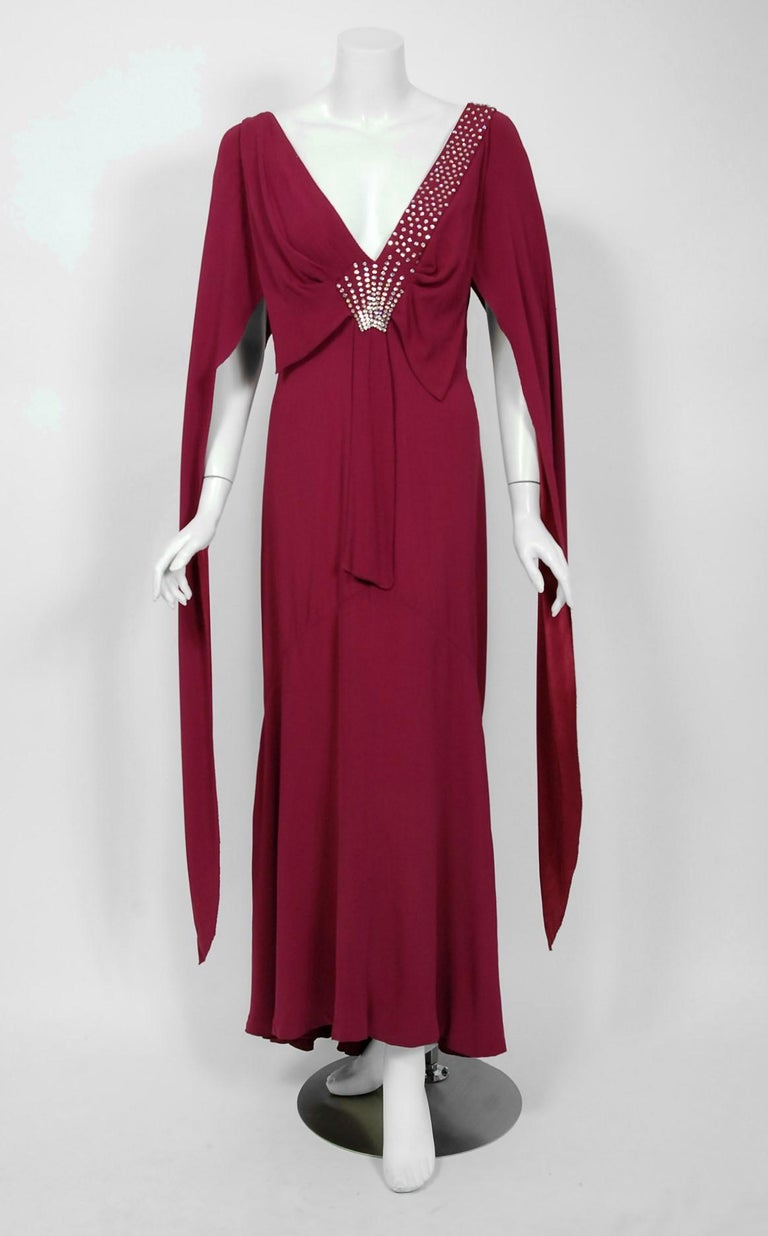A breathtaking 1930's couture custom-made plum purple silk crepe gown from the Old Hollywood era of glamour. There is so much detail, you can tell this masterpiece was created with love and care. The bodice has a seductive sculpted plunge with