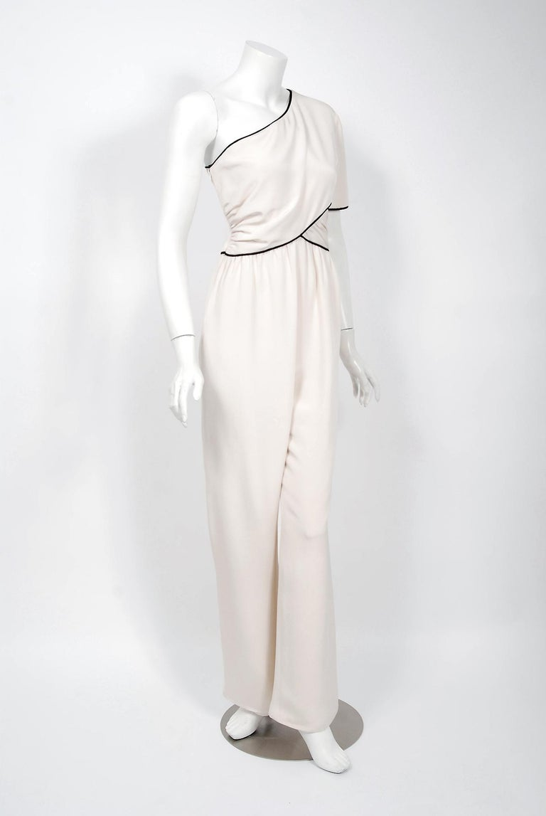 Gorgeous Bill Blass Couture ivory-creme silk jumpsuit dating back to his 1979 collection. Building upon the innovations of European designers such as Coco Chanel, Blass made clothes that allowed women a modern sense of ease. He made glamorous