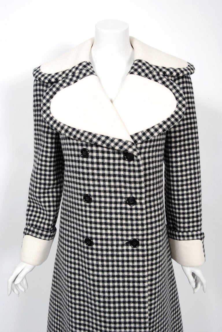 Incredibly chic Geoffrey Beene Couture black and creme checkered wool coat dating back to the mid 1960's. Geoffrey Beene made strong impressions with his courteous manner as well as his highly original style. He was a champion of minimalist design.