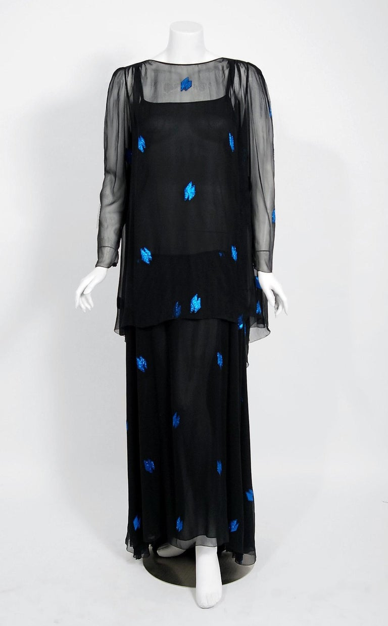 A gorgeous Christian Dior Paris black and sapphire blue show-stopper dating back to their 1972 collection.  When the talented Marc Bohan took over as head designer in 1960, he continued the Dior tradition of elegant design and this beautiful