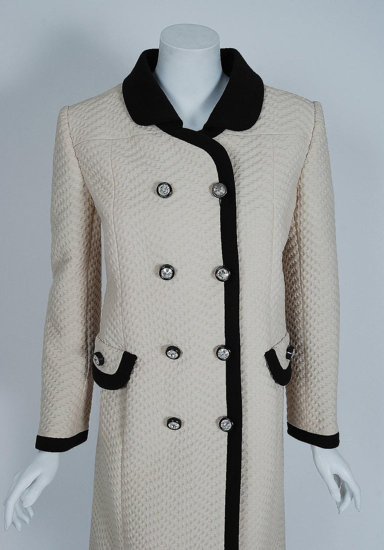 Stunning 1960's Ognibene Zendman Italian designer coat fashioned in the most fabulous crème & black waffle silk-pique. Founded in 1965,  the Ognibene Zendman couture house was known for designing elegant, clean and tailored creations using muted