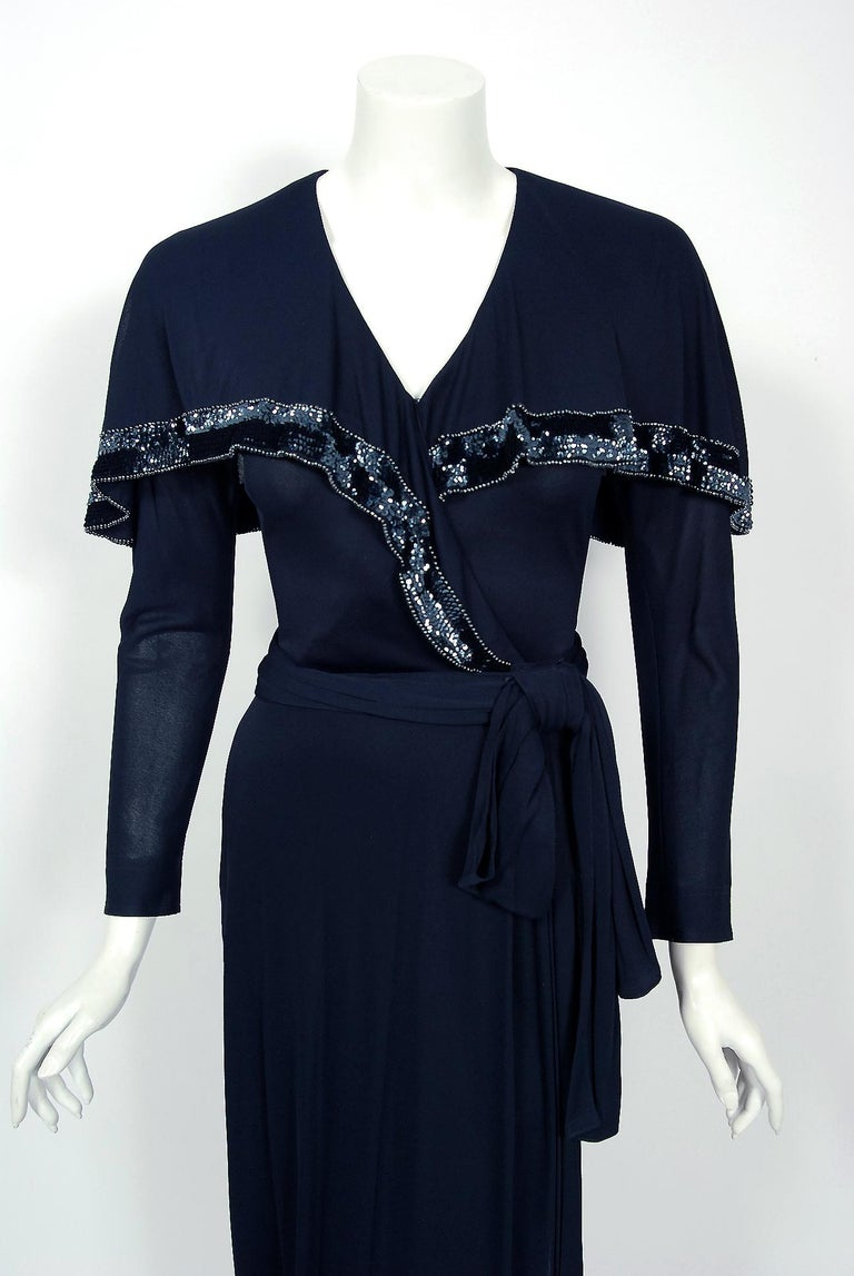 A gorgeous 1977 Jean Muir designer silk-jersey dress with original deadstock $2895 price tags still attached. The self-taught Muir made her name in the 1960's, creating a reputation for exquisitely tailored, timeless, feminine clothing. Muir is