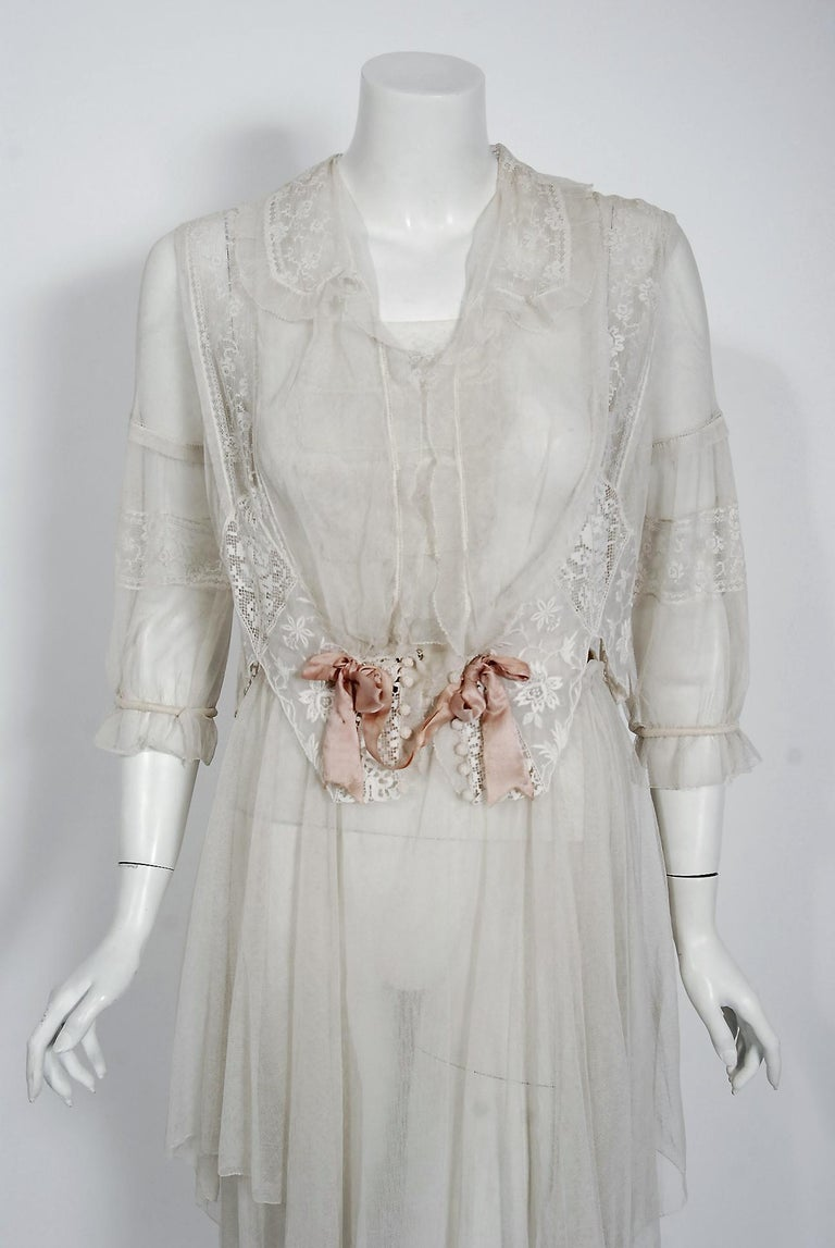 Romantic white dresses from the early 20th century are perennial favorites and this one is a show-stopper. The garment's complete couture style is so modern; the fine fabrics are a treasure trove of needle art. The dress is made up of four different