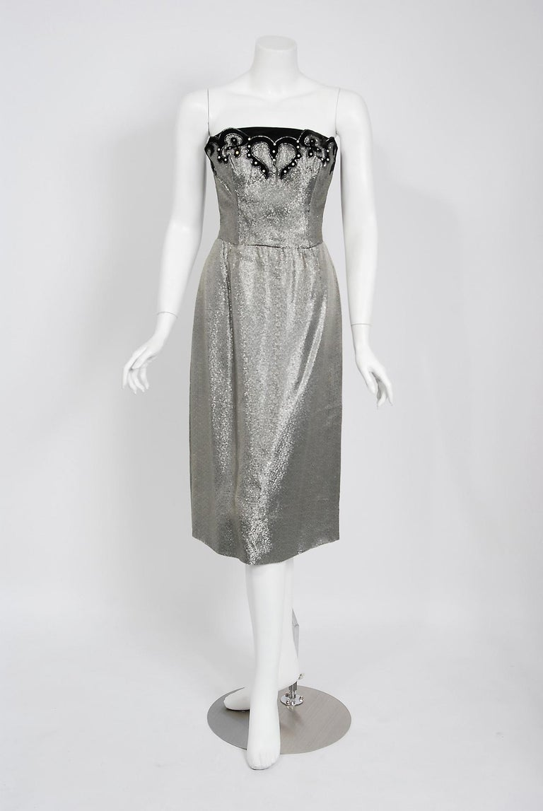 A seductive and highly stylized 1950's sparkling silver lamé dress ensemble by the famous Lilli Diamond label. The silhouette is classic pin-up