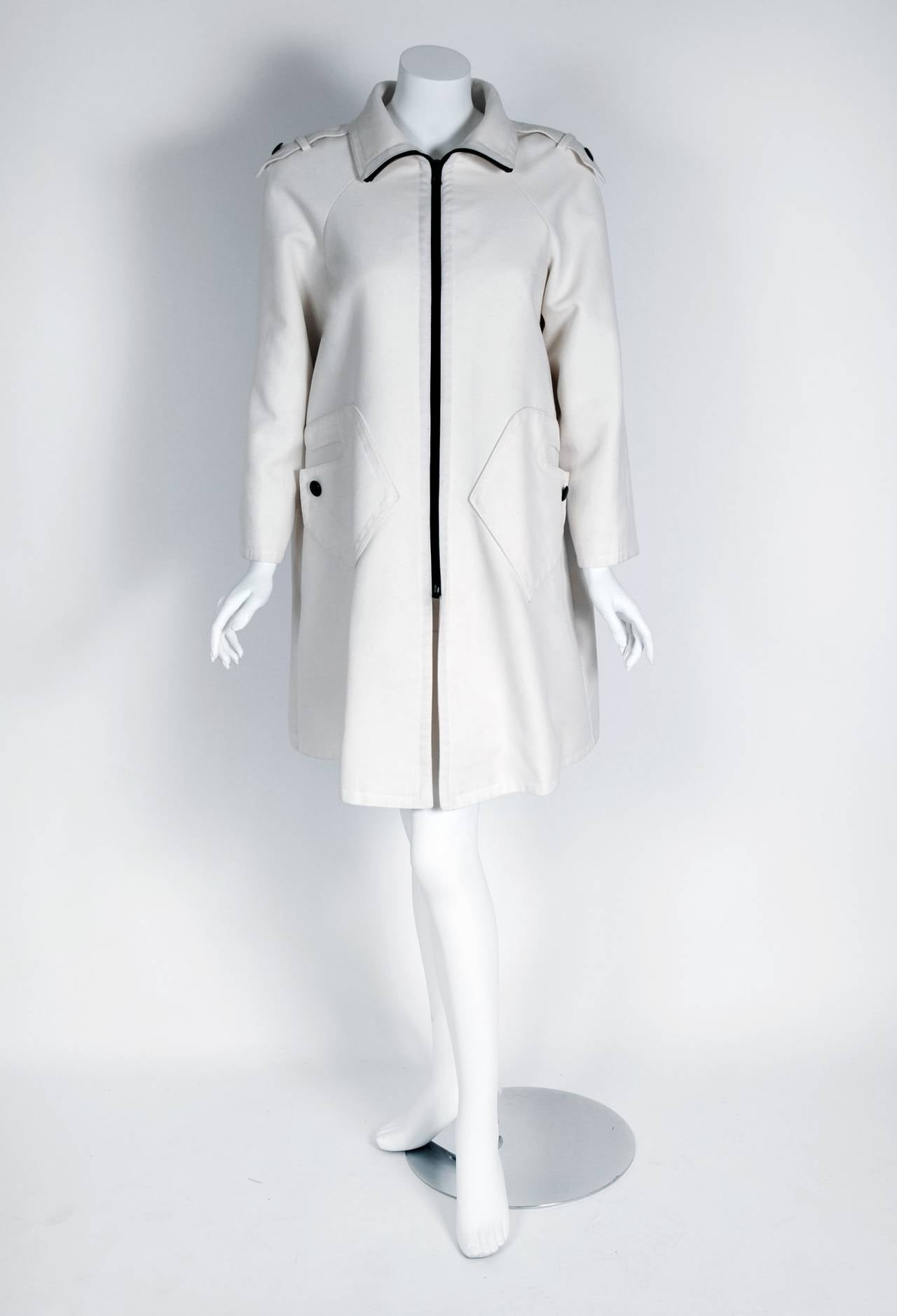 Marvelous 1968 Pierre Cardin designer jacket in a rich fully-lined white cotton twill. In 1951 Cardin opened his own couture house and by 1957, he started a ready-to-wear line; a bold move for a French couturier at the time. The look most associated