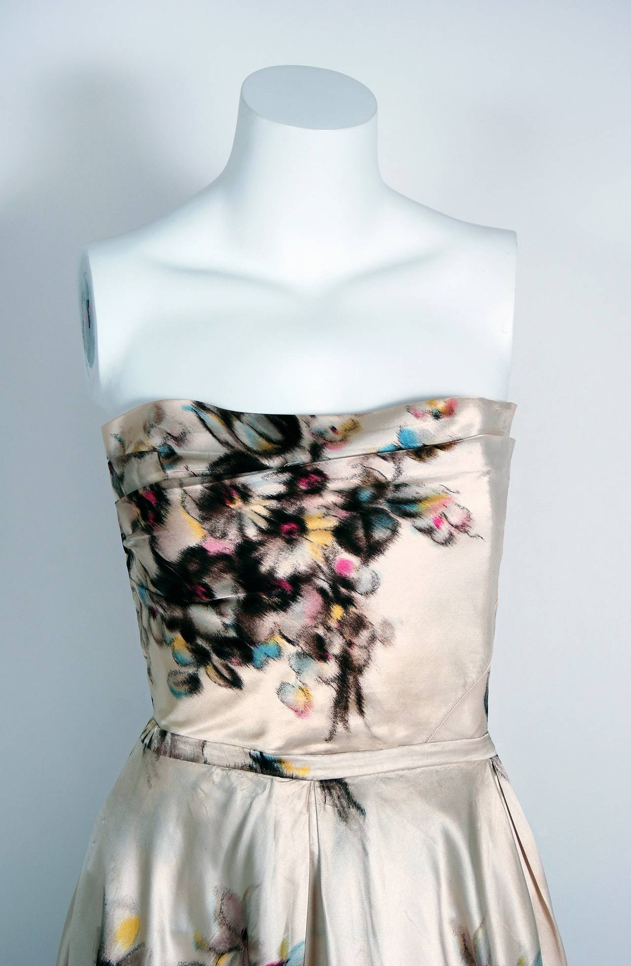 """Breathtaking Jeanne Lafaurie Couture watercolor garden gown from the 1950's """"new look"""" era of fashion. Jeanne Lafaurie was a Paris couturiere, designing from 1925 until 1958, whose house was known for spectacular fabrics and fine draping. Andre"""