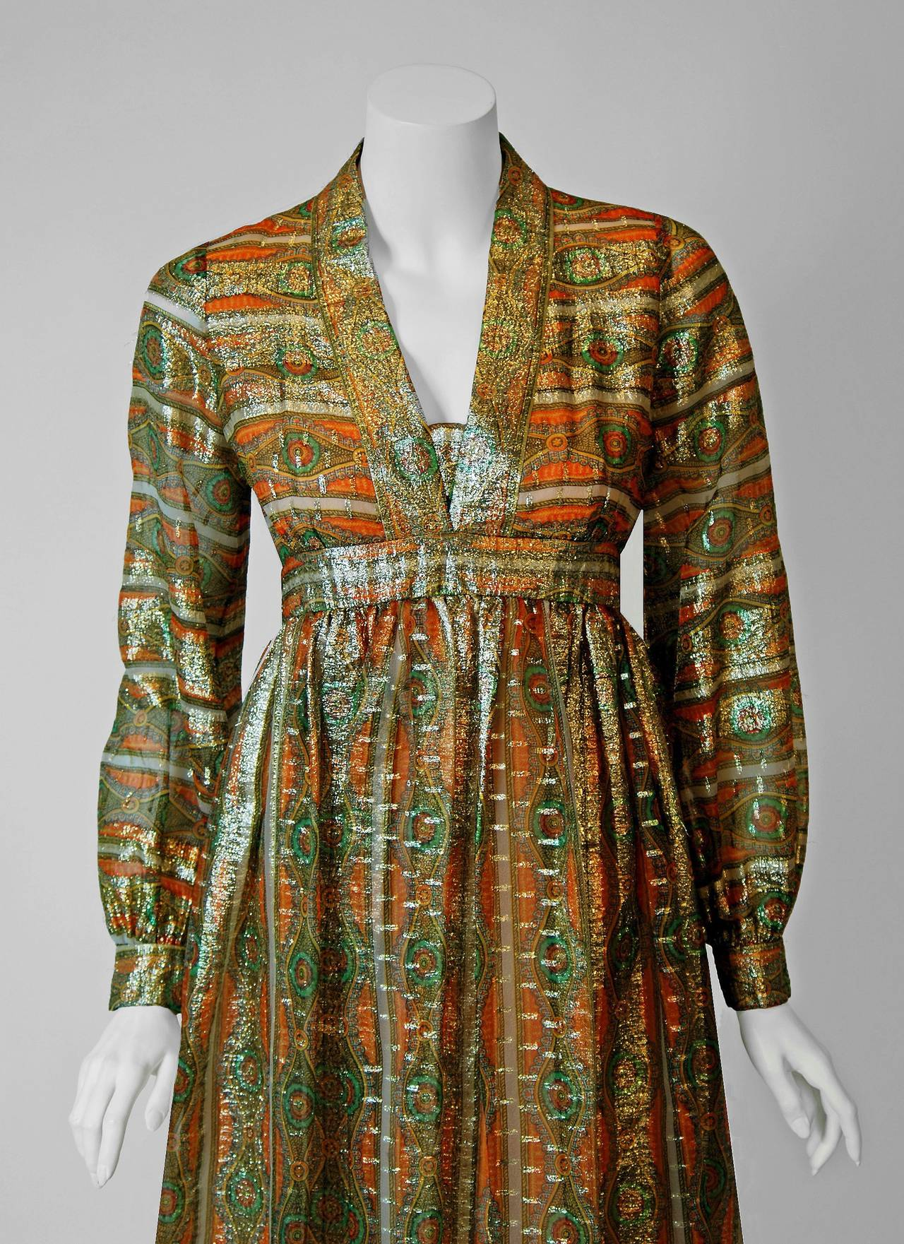 Gorgeous 1970's Indian metallic art-nouveau inspired print silk dress from the high-end Houston boutique, Esther Wolf. The luxurious fabric is lightweight and effortless to wear. The fabric used for this garment is so sensational, it shimmers with