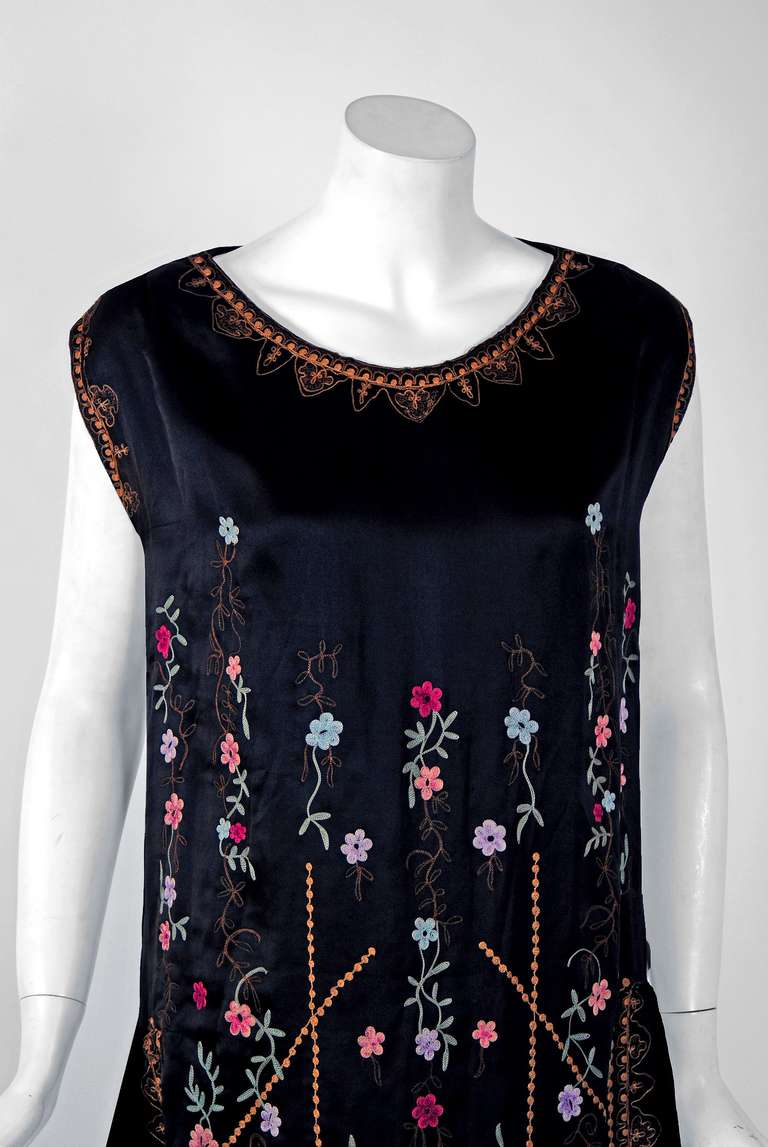 Breathtaking 1920's museum quality silk-satin evening dance dress. The ethereal colorful floral pattern touches a deep chord in our collective aesthetic consciousness. As fashion lovers, we never tire from metallic embroidery; it will always be