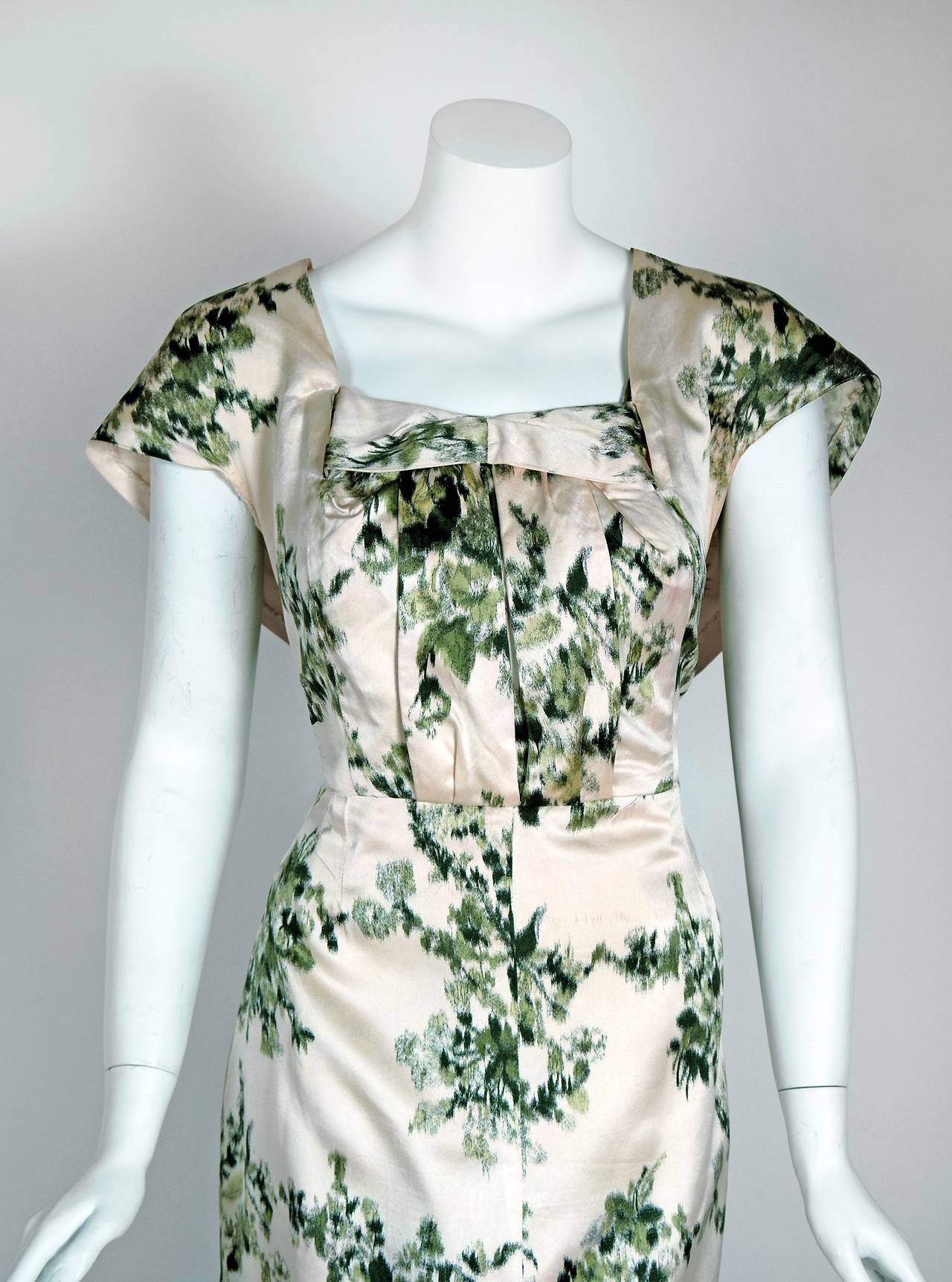 """Breathtaking Lucile Manguin Haute-Couture ivory and green silk-satin cocktail from the 1950's """"new look"""" era of fashion. Lucile Manguin was a Paris couturiere, designing from 1928 until 1960, whose house was known for spectacular fabrics and fine"""