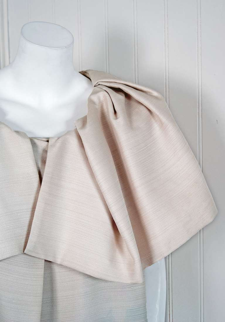 """In this gorgeous early 1960's """"Scaasi"""" designer cape jacket, the detailed construction and meticulous attention to detail are comparable to what you will find in modern haute-couture. Arnold Scaasi was an acclaimed fashion designer who created"""