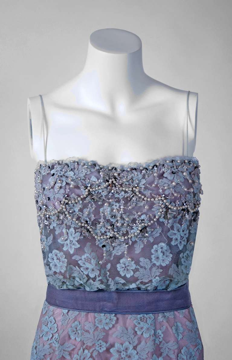 """Breathtaking 1950's hourglass cocktail dress by the famous """"Ceil Chapman"""" label. This garment is incredibly beautiful in person and equally astounding when one actually sees the level of construction. The blue-lilac periwinkle French"""