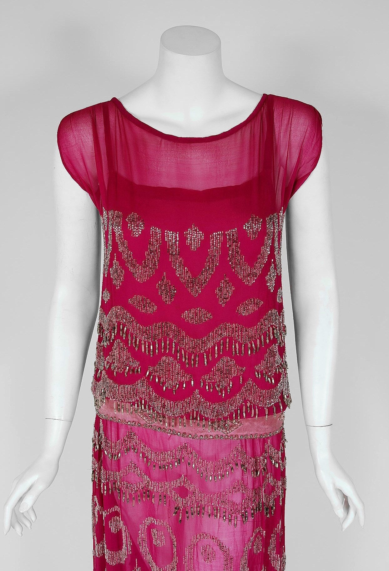 Breathtaking 1920's French designer silk-chiffon evening dance dress. The ethereal magenta-pink color palette touches a deep chord in our collective aesthetic consciousness. As fashion lovers, we never tire from antique beadwork & sparkle; they