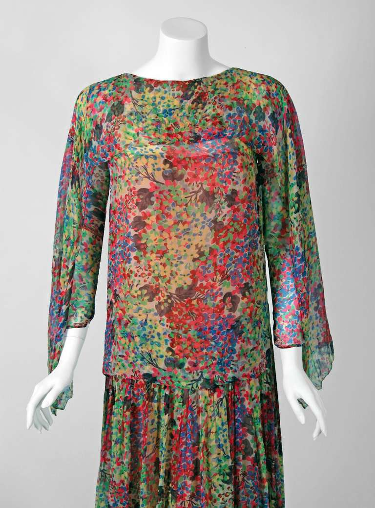 The breathtaking watercolor floral-garden print used in this late 1920's silk-chiffon flapper dress has a fresh innocence that I find irresistible. A unique flying panel drapes across the bodice and down both arms. I love the way it flows when you