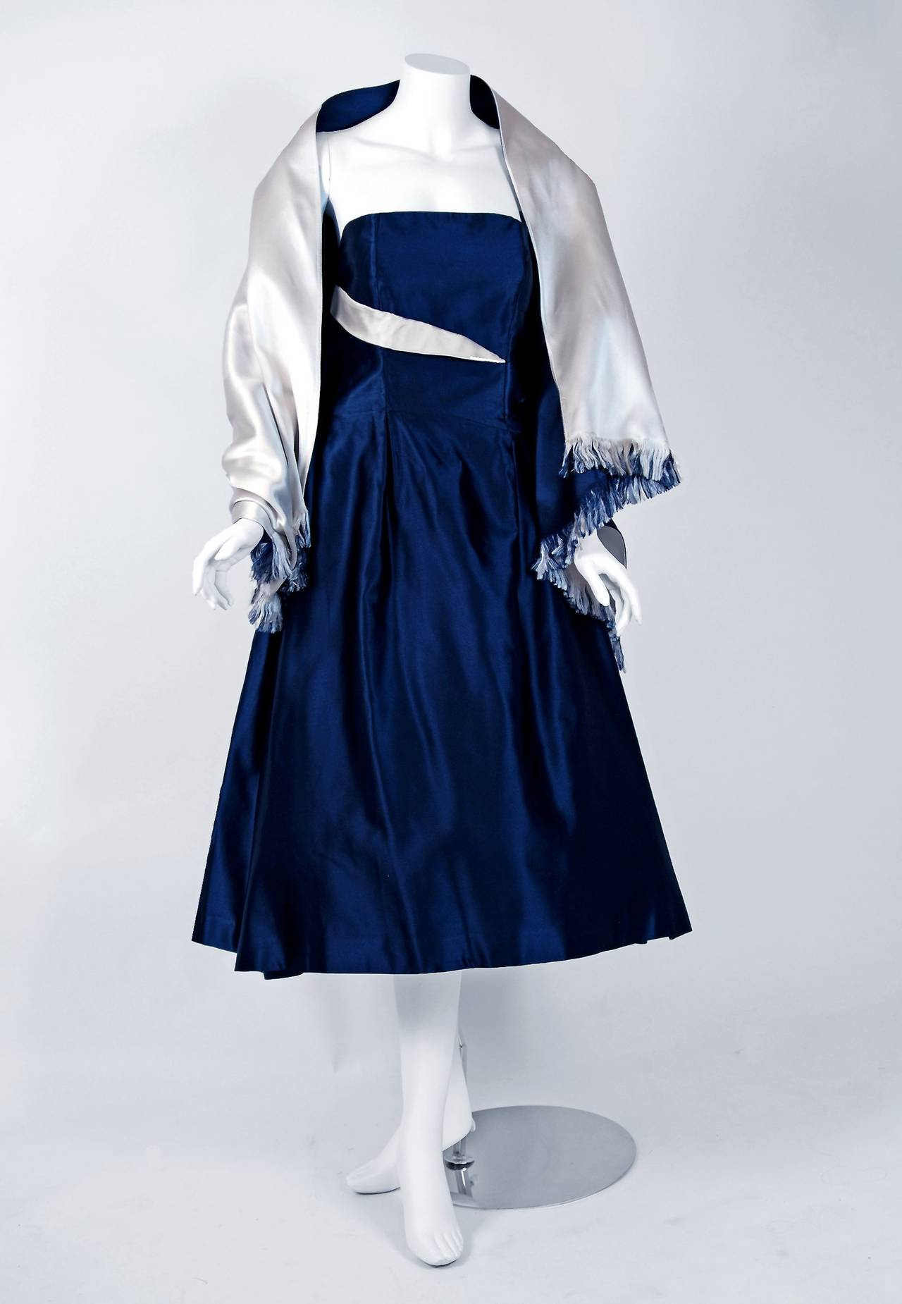 Breathtaking Jeanne Lanvin Castillo navy-blue & ivory satin cocktail dating back to 1955. Castillo was invited by Jeanne Lanvin's daughter to design for her mother's firm in Paris, with hopes of relaunching the firm's name. Jeanne Lanvin, the