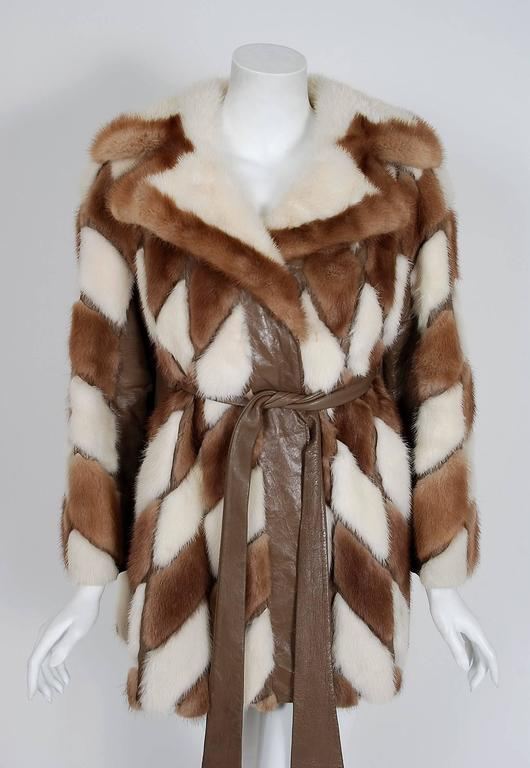 "This exquisite 1960's ""Borgersen's Fur Seattle"" designer genuine mink-fur and leather coat will make any woman shine during the upcoming cold winter months. The soft ivory-white and brown mink has been worked into an almost deco-chevron pattern and"