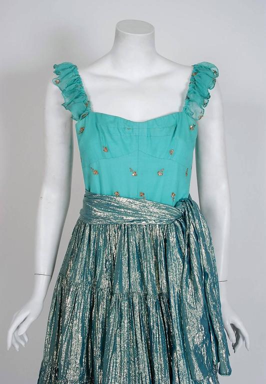 A breathtaking Thea Porter Couture dress ensemble that is unlike any I've ever seen! This extraordinary garment is fashioned in luxurious turquoise metallic lame and embroidered silk-chiffon. I adore the low-cut sweetheart plunge, fully boned, gypsy